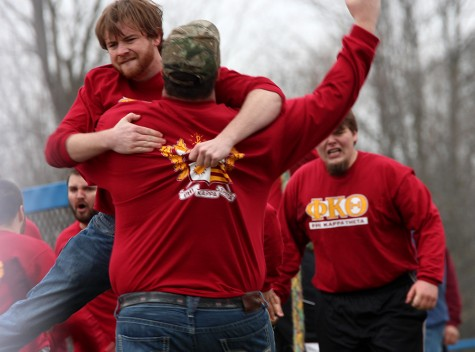 John Hopkins, a senior English major and a coach for Phi Kappa Theta, jumps into the arms of another coach after the Phi Kaps win against Pi Kappa Alpha during the Tugs competition Monday at the Campus Pond.