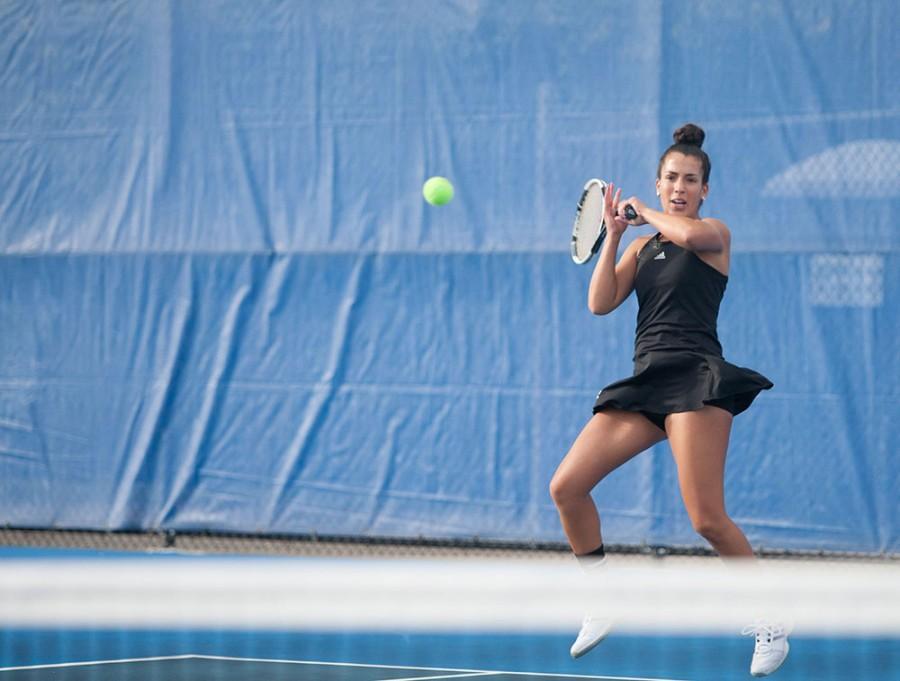 Senior Sephora Boulbahaiem, hits the ball during the Women's tennis game on Oct. 6, 2014.