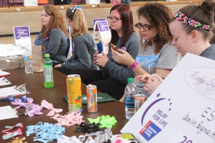 Members of Epsilon Sigma Alpha sell ribbons, bows, and cupcakes to help raise money during Relay for Life Sunday in McAfee Gymnasium.