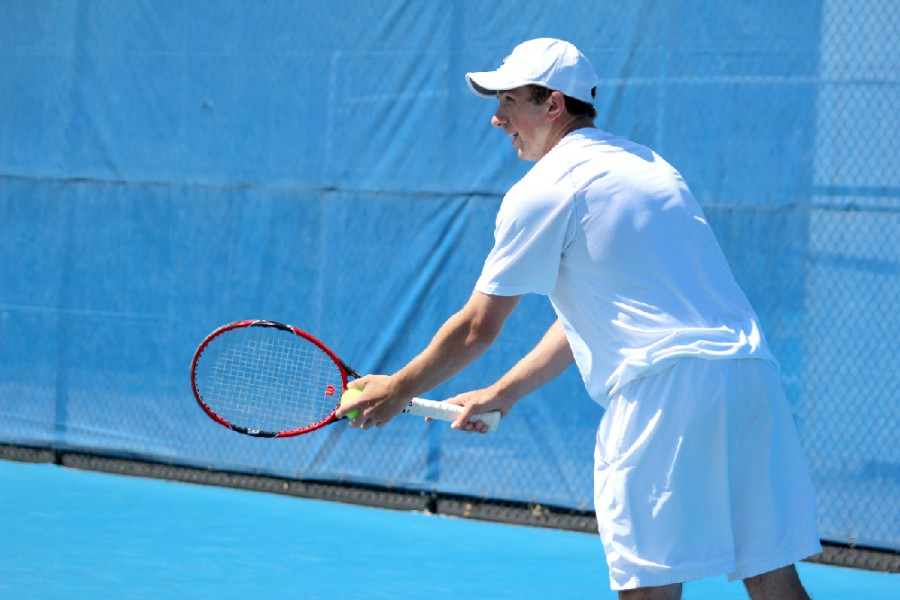 Junior Rui Silva prepares to serve the ball during the Eastern Men's tennis match Saturday at Darling Courts.