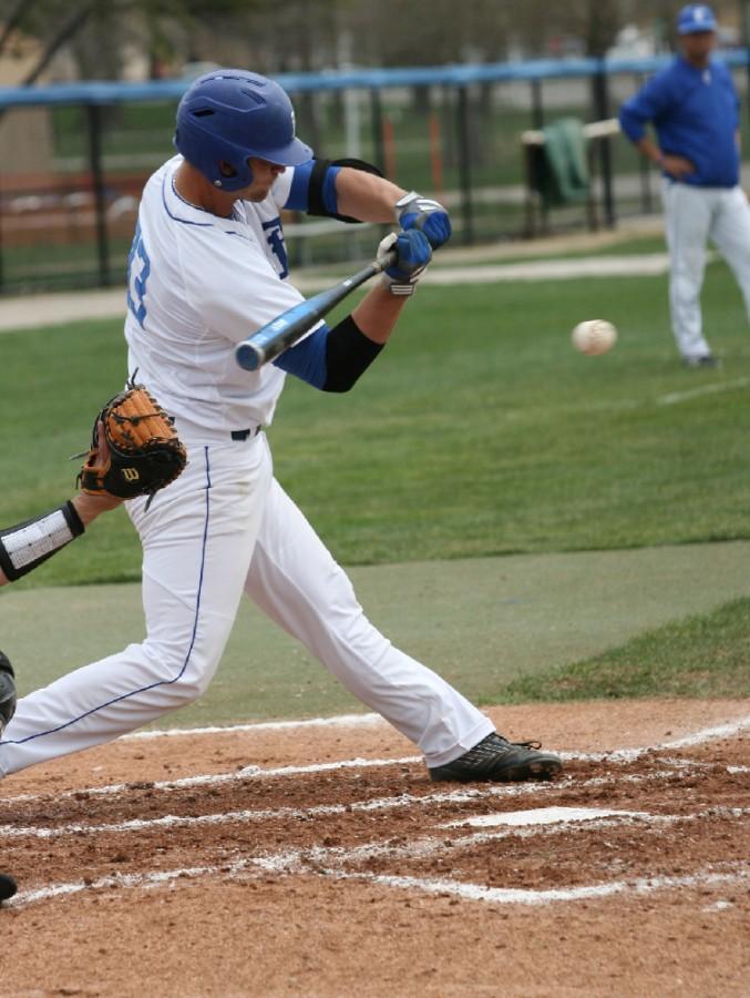 Senior Infield Brant Valach hits the ball during the Eastern men's baseball game vs SouthEast Missouri Sunday at Coaches Stadium.