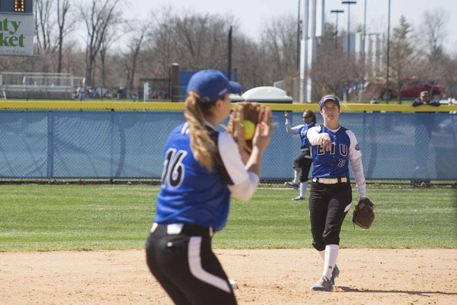 Freshman infielder Katie Watson passes the ball to Sophomore pitcher Hannah Rachor during the Eastern women's softball game on April 4, 2015.