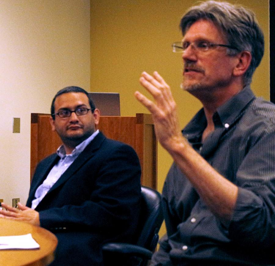 History professor Brian Mann (Left) listens to fellow panelist Newton Key, also a history professor, as he discusses the importance of geography in relation to ISIS Tuesday in the Booth Library conference room.