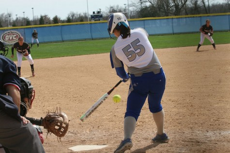 Kylie Bennett, a junior, makes a swing at the ball at the EIU vs Jackson State softball game on Sunday at the softball field.