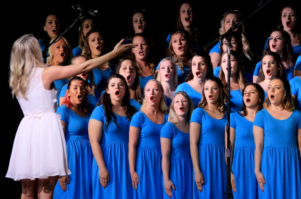 Members of the Delta Delta Delta compete in Greek Sing on Sunday in Lantz Arena.  The sorority won the competition for the seventh straight year.