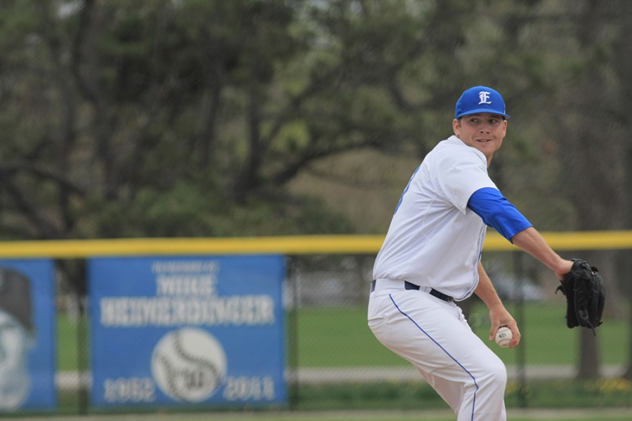 Garrison Stenger, a senior pitcher, gets ready to throw the ball to the batter during the game against Illinois College Wednesday.