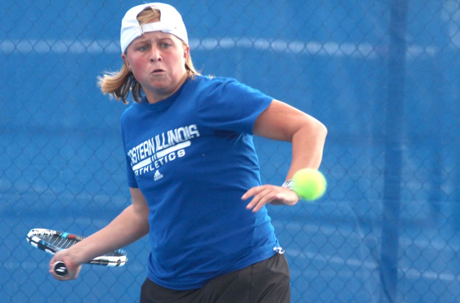 Grace Summers, a freshman member of the women's tennis team, attempts to return a serve at Darlings Courts in practice Mon. Oct. 6,2014.