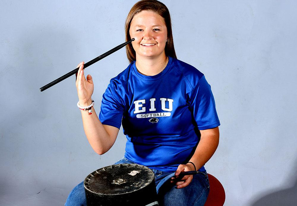 Andrea Roberts, a freshmen catcher for the Panthers' softball team, not only aids her team in games she also provides them their own soundtrack while beating buckets at some games.