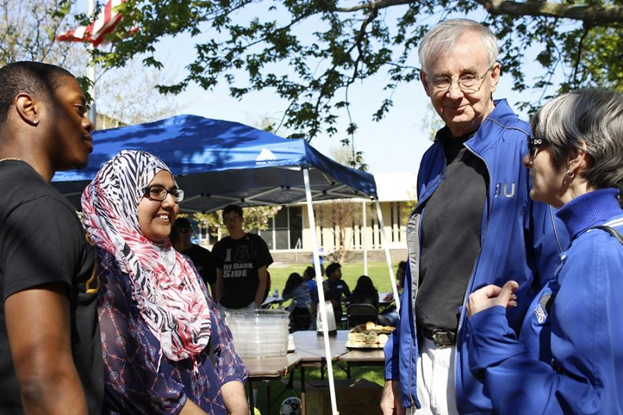 President Bill Perry and his wife, Linda, talk with Eastern's current student body President Reginald Thedford, Jr, a senior Political Science major, and next semester's student body president, Shirmeen Ahmad, a junior journalism major, during Picnic with Prez Wednesday on the South Quad.