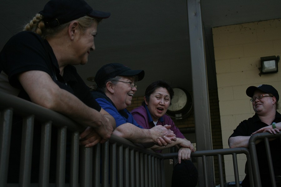 Martin Luther King Jr University Union employees share a laugh during their break Monday  afternoon.