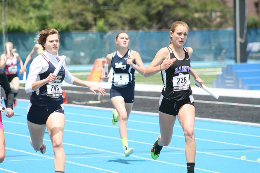 IHSA competitors run the relay during the IHSA State Track and Field competition, Thursday at O'Brien Stadium.