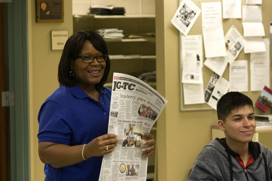 Lisa Green of the Fort Wayne (Ind.) Journal Gazette explains bylines to students during the 2015 Illinois Press Foundation high school journalism workshop Monday afternoon in the Student Publications newsroom in Buzzard Hall. Green, a 1986 Eastern alum, has returned to campus every summer for 20 years to serve as associate director of the workshop. Eastern's journalism department co-sponsors the workshop every year.