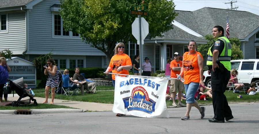 A Bagelfest banner was walked down the parade after the emergency vehicles to signal the beginning of the rest of the parade, which celebrated the 30th anniversary of the event.