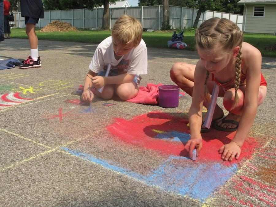 Children compete in the Chalk-in Saturday as part of Red, White and Blue Days in Morton Park