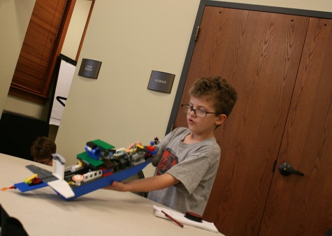 Christopher Holt, 7, of Charleston, plays with his Lego ship Wednesday during the Lego Club at Charleston Carnegie Public Library. Christopher just recently finished the second grade.