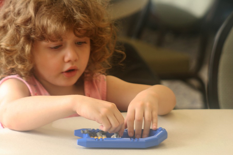 Christine Holt, 5, of Charleston, plays with a Lego rescue boat during the Lego Club held in Charleston Carnegie Public Library every month. Out of the 14 kids that attended the event only 3 were girls.