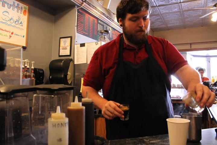 Dustin Weisman, a barista at The Jackson Avenue Coffee, prepares a mocha Tuesday at the JAC.