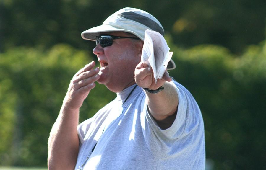 Mark Hutson directs players during football practice, Tuesday. Hutson is the new offensive line coach for the Panthers. He has coached at Eastern before, most recently the 2006 season. In addition, he has spent the last three years as tight end coach for the Oakland Raiders.