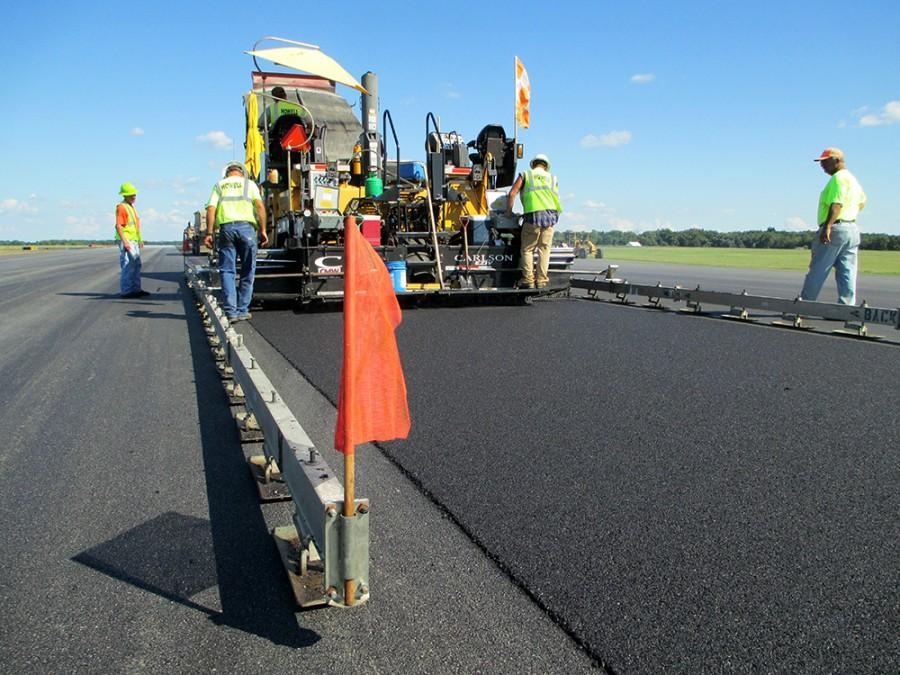 Workers+of+Howell+Paving+in+Mattoon+lay+down+the+asphalt+for+the+construction+of+Runway+11+at+the+Coles+County+Memorial+Airport+over+the+summer.+The+airport+will+close+to+finish+construction+in+September.