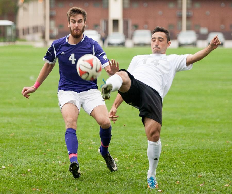 Former Eastern player Will Butler clears the ball up the pitch during a match against Western Illinois on Nov. 18, 2014 at the Eastern practice field.  The Panthers lost to the Leathernecks 1-0.