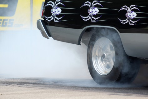 Ron Hill, a villa grove resident, spins the tires on his 1975 Dodge Dart before he lines up for his first time trial Saturday at the Coles County Dragway. Hill said he built his car by himself, but his cousin helped him out with the interior.