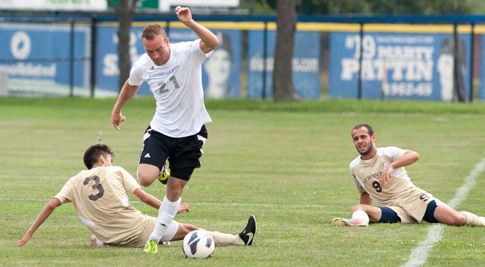 Junior Davis Wegmann avoids slide tackles by two St. Francis opponents in a game on Aug. 30, 2014 at Lakeside Field.