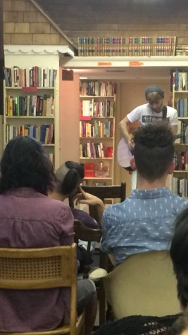 Harrison Rollings performs for the audience at Bob's Bookstore during open mic night on Friday. Rollings performs original works for the estimated 20 people in attendance.