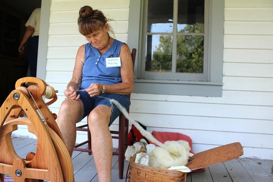 Jeannie+Ahasay%2C+a+volunteer+at+the+Five+Mile+House%2C+demonstrates+how+women+in+pioneer+times+would+spin+yarn+out+of+sheep%27s+fleece+on+Aug.+30.+Ahasay+said+it+would+probably+take+about+three+to+five+hours+to+spin+one+spindle+of+yarn+if+she+sat+down+and+just+did+that.