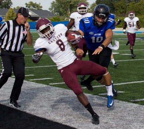 Eastern Kentucky defensive back Johnny Joseph is shoved out of bounds by former Eastern quarterback Jimmy Garoppolo in a game on Sept. 28, 2013 at O'Brien Field.