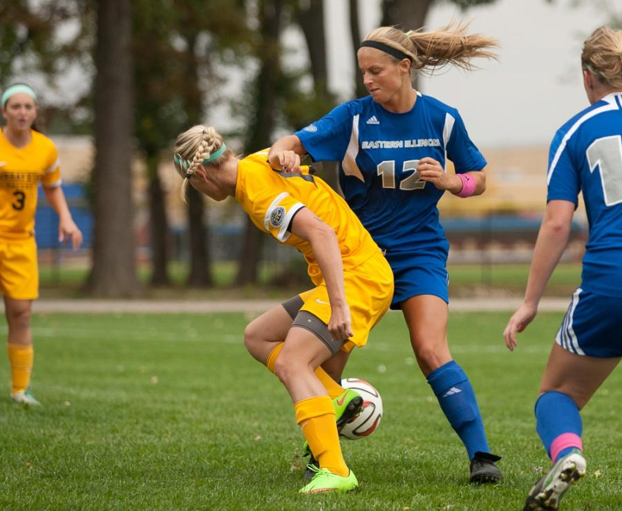 Senior midfielder Molly Hawkins attempts to dispossess an opponent during a match on Oct. 17, 2014 at the Eastern practice field.
