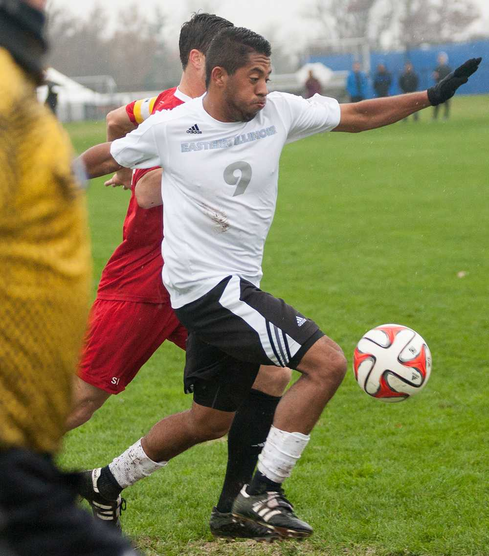 Senior forward Tayron Martin moves the ball up the pitch during the Panthers' 4-3 extra time loss to Southern Illinois-Edwardsville on Nov. 11 2014 at Lakeside Field.