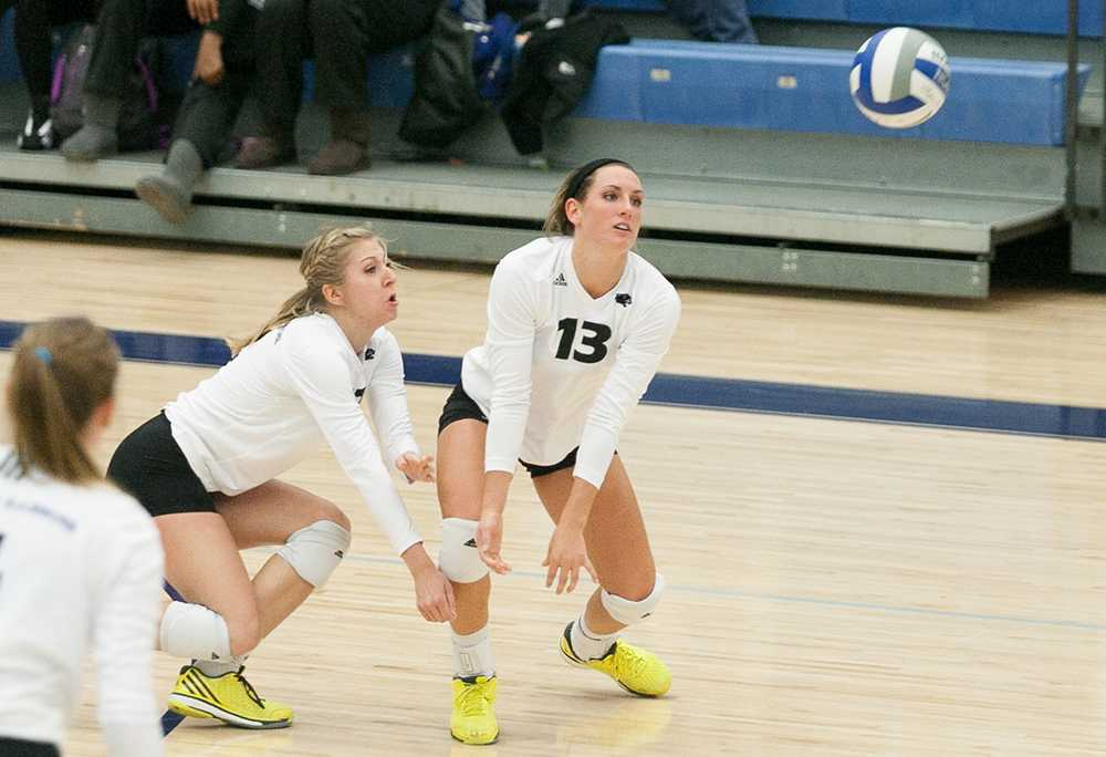 Red-shirt senior defensive specialist Kelsey Brooke and freshman outside hitter Maria Brown go for the dig during a match against Southeast Missouri  in Lantz Arena. Oct. 31 2014