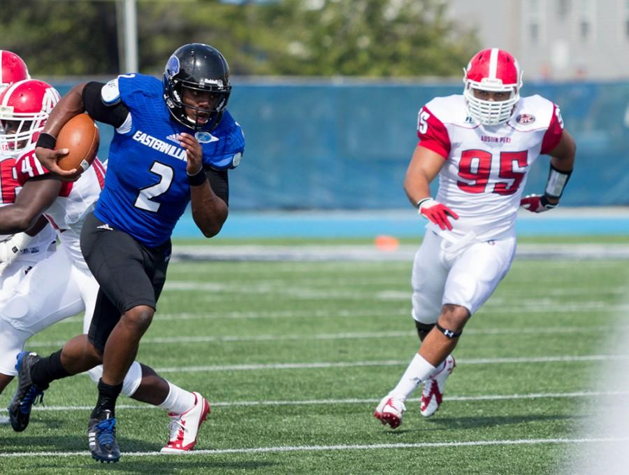 Junior quarterback Jalen Whitlow runs with the ball down field against Austin Peay on Sept. 21, 2014 at OBrien Field. Whitlow set an Eastern record, with 137 rushing yards by a quarterback, as the Panthers won 63-7.