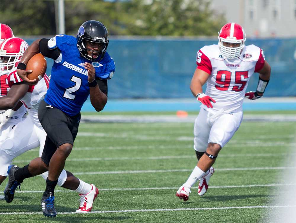 Junior quarterback Jalen Whitlow runs with the ball down field against Austin Peay on Sept. 21, 2014 at O'Brien Field. Whitlow set an Eastern record, with 137 rushing yards by a quarterback, as the Panthers won 63-7.