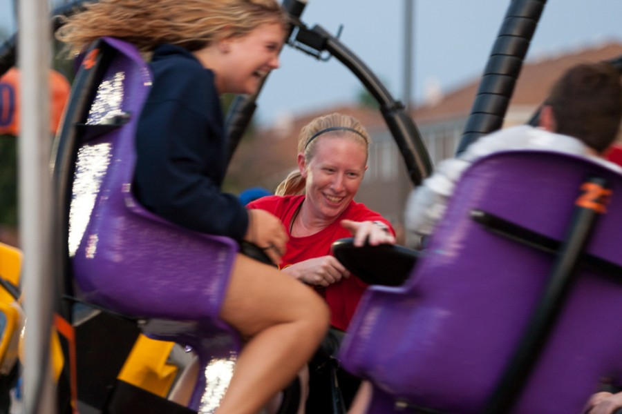 Senior kinesiology and sports studies major Megan Langenhorst rides the Tornado during Quakin' in the Quad held in the parking lot at the corner of Ninth Street and Roosevelt Avenue on Saturday.  Langenhorst wanted to hang out and catch up with her friends after the summer.