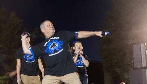 Eastern president David Glassman winds up to throw a t-shirt out to the assembled crowd during FIrst Night on Sunday on the South Quad.
