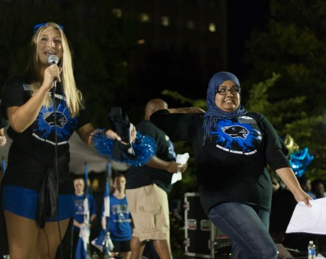 Catie Witt, executive vice president and Shirmeen Ahmad, student body president, welcome students to campus during First Night on Sunday on the South Quad.