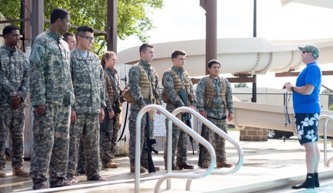 A wave of cadets listens as Captain Daniel Alix gives instructions before they enter the water for combat water training on Thursday at the Charleston Rotary Pool.