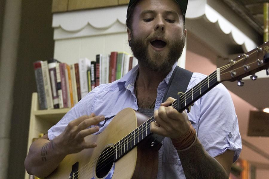 Jeremy McConnaha, a Mattoon resident, performs with this acoustic guitar for the Open Mic Night on Friday at Bob's Bookstore. It was McConnaha's first time performing at the bookstore.
