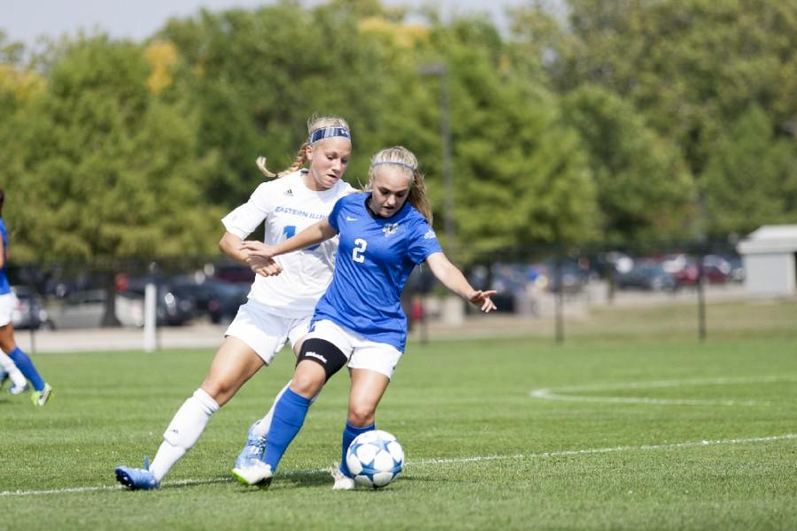 Freshman Kate Olson runs behind IPFWs Kassidy Simpkins during the Panthers 3-1 victory on Sept. 4 at Lakeside Field.