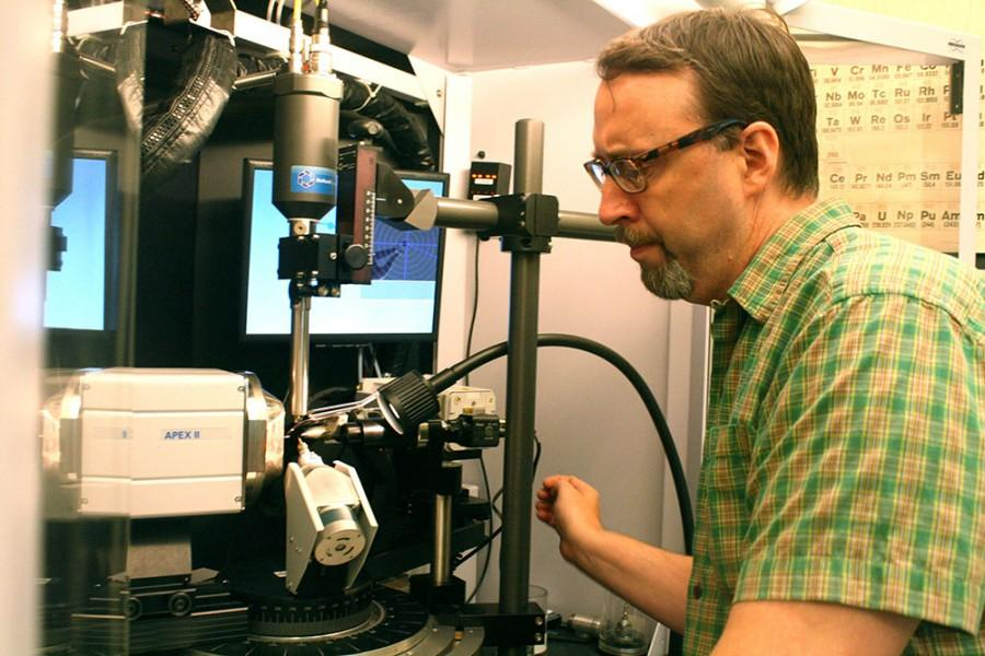 Dr. Kraig Wheeler, a professor of chemistry  demonstrates an X-Ray machine in a chemistry lab in the physical science building on Thursday. The machine exposes crystals to X-Rays to determine molecular structure and crystal structure.