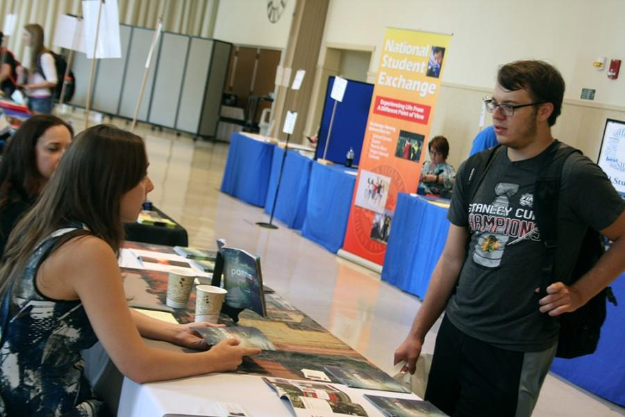 Eric Micheli, a freshman chemistry major speaks with University Relations Manager, Ellen Knuth Tuesday during the Study Abroad Fair in the University Ballroom in the Martin Luther King Jr., University Union. Micheli was in attendance for general information regarding study abroad.