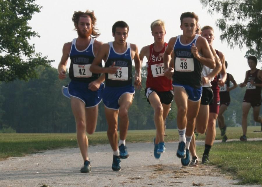 Eastern runners Riley McInerney, Paxson Menard, Tyler Yunk, and Southern Illinois-Edwardsville runner Keith Meyer race in the EIU Walt Crawford meet on Friday on the Panther Trail. Eastern won both the mens and womens meets.  McInerney finished first and Menard second.