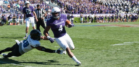 Northwestern's Solomon Vault avoids the tackle by red-shirt sophomore safety Vince Speller during the Panthers' 41-0 loss at Ryan Field in Evanstan, Ill