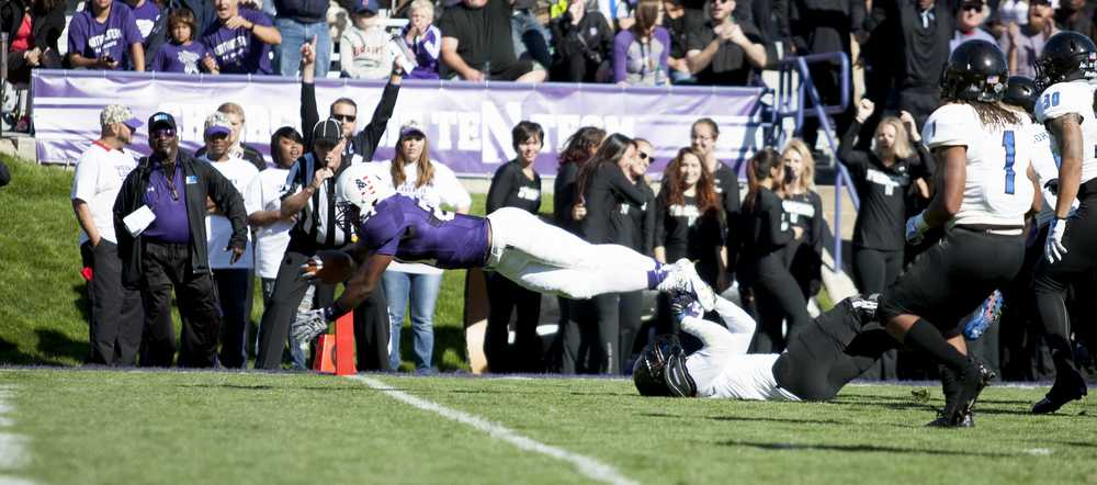 The Panther defense fails to prevent a touchdown by Northwestern's Justin Jackson during the 41-0 loss on Saturday at Ryan Field in Evanston, Ill.