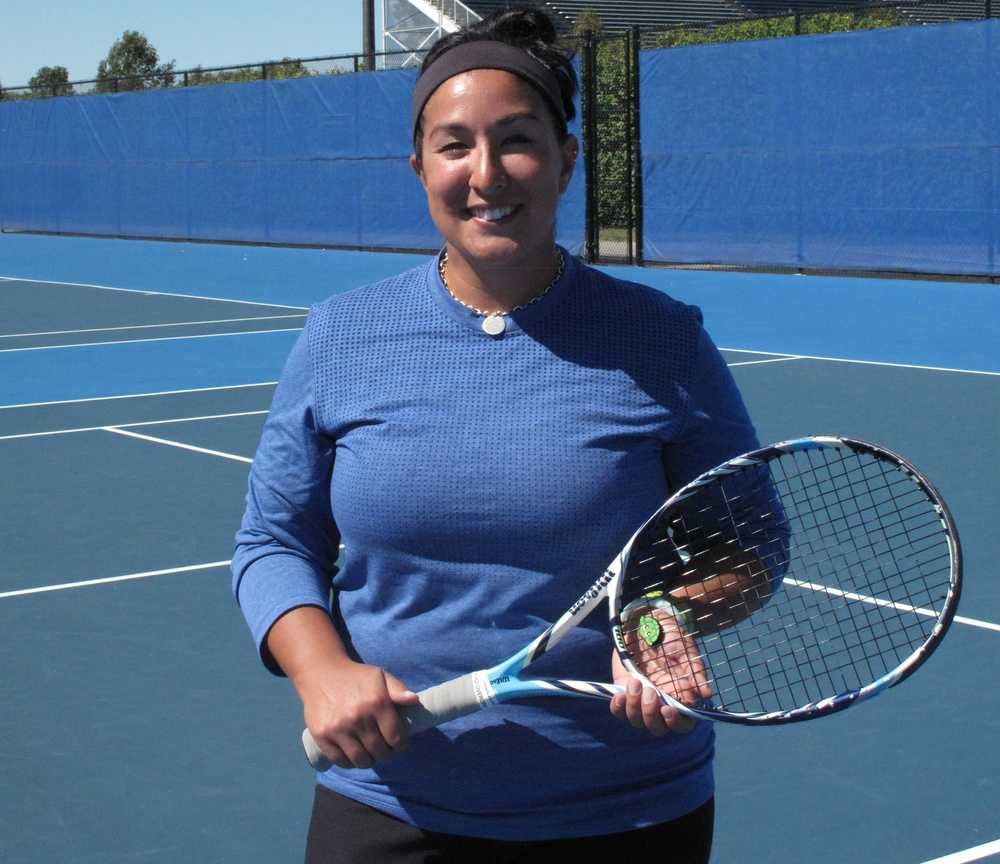 Emily Wang, the new head women's tennis coach came to Eastern from The Dodds Tennis Center in Champaign. This will be the first collegiate coaching job for Wang.