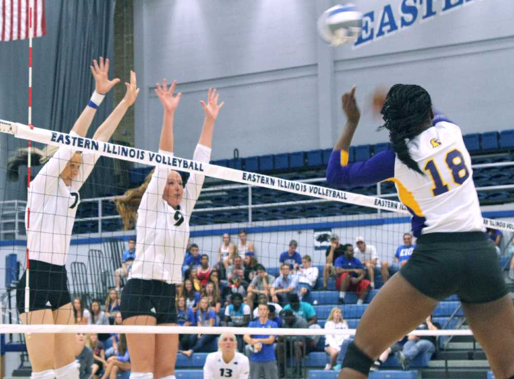 Freshman hitter Taylor Smith and sophomore hitter Allie Hueston attempt to block the hit from sophomore hitter Kellie Williams of Tennesee Tech in the third set of the Panthers first conference game of the season Friday inside Lantz Arena.