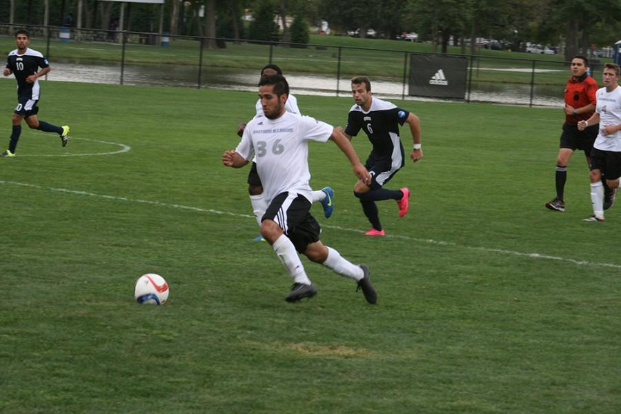 Redshirt+junior+midfielder%2C+Gabriel+Puga+runs+upfield+during+Saturday%E2%80%99s+game+against+Oral+Roberts.
