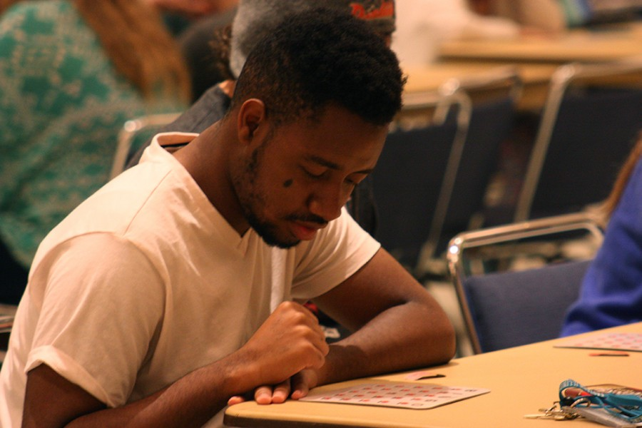 """Kendall Barnes, a sophomore Kinesiology major plays bingo during ROCfest in the Grand Ballroom of the Martin Luther King, Jr. University Union on Monday.  When asked about the bingo game Barnes replied, """"It's getting intense!"""""""