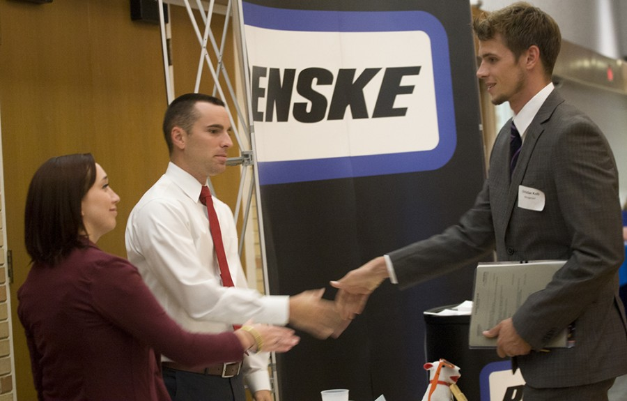 Christian+Kolb%2C+a+senior+management+and+information+system+major%2C+shakes+hands+with+representatives+of+Penske+on+Wednesday+during+the+Job+Fair+in+the+Grand+Ballroom.